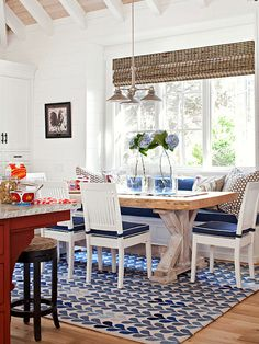 Navy and white create a classic cottage-inspired color scheme for this friendly space. Tour the rest of this pretty home: http://www.bhg.com/decorating/decorating-style/cottage/cottage-for-entertaining/?socsrc=bhgpin041213navybanquette=8