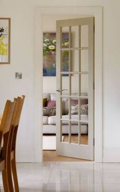 Interior Doors | French pine door between dining room and living room | Bayer Built Woodworks
