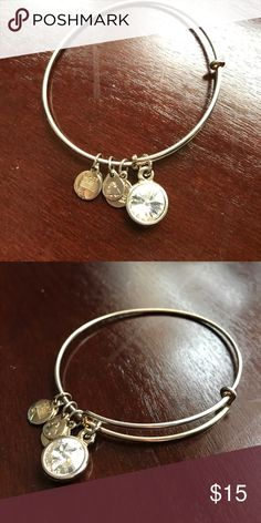 Gold Alex and Ani Bracelet Gold Alex and Ani bracelet with silver gem. Gently worn! Alex & Ani Jewelry Bracelets