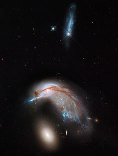Colliding Galaxy Pair Takes Flight This striking NASA Hubble Space Telescope image, which shows what looks like the profile of a celestial bird, belies the fact that close encounters between galaxies are a messy business. This interacting galaxy duo is collectively called Arp 142. The pair contains the disturbed, star-forming spiral galaxy NGC 2936, along with its elliptical companion, NGC 2937 at lower left.