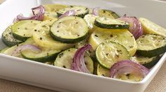 Italian Roasted Vegetables - 1yellow &1Green squash/Zuchinni, 1red onion, 1 tbl spoon oil, 1/4 tsp basil, Salt and Pepper to taste