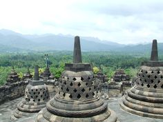 Borobudur stupas overlooking a mountain. For centuries, it was deserted. Now, it is again both a shrine to the Lord Buddha and a place for Buddhist-Pilgrimage.