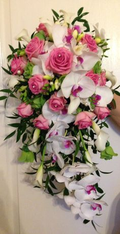 Beautiful fresh shower bouquet created using cherry lip phalaenopsis orchids, dusky pink roses and the beautifully scented freesia. www.am-flowers.co.uk
