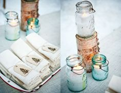 Winter party decor--clear and blue vintage mason jars filled with snow and a votive candle, and birch log candle stands.