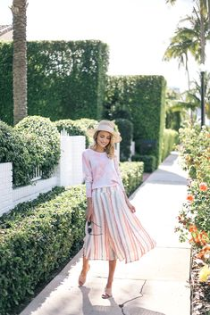 Pink palm print sweater, Anthropologie midi skirt, blush suede mules, preston and olivia hat