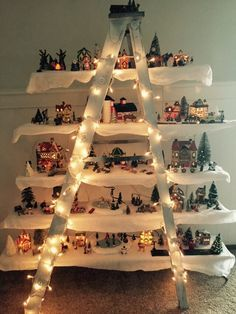 This is made with a ladder and boards screwed to the steps and christmas village ladder decor solutioingenieria Choice Image