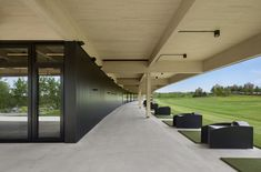 View the full picture gallery of Clubhouse For Golf Exécutif Montréal Archery, Montreal, Clubhouse Design, Wooden Panelling, Golf Range, Golf Simulators, Golf Practice, Golf Tips For Beginners, Golf Shop