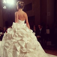 Check out the back of this @pninatornai ball gown! We'd say yes to this dress at @kleinfeldbridal #bridalmarket #bridalfashionweek