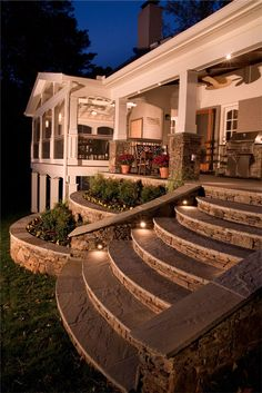 Tapered stone steps to open porch. Notice the tiered retaining walls, stpe lights and attached screen porch. | coloradodecks.com