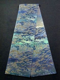 "This is a remarkable SAHARI Tsuzure Hon-Fukuro Obi that enhances true jewel-like sparkles from allover the obi. It is titled as ""The garden of Katsura Imperial Villa"" and the tasteful pattern is woven."