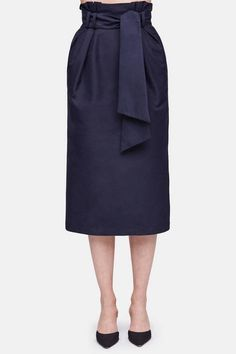 """""""I wanted to create a brand that reflects a slower pace and process,"""" says designer Gabriela Hearst, """"where things are made with care and detail."""" Her approach is demonstrated by this striking skirt from the resort 2017 collection. Made in Italy of lustrous cotton, it gains a ruffled flourish from the paperbag waist and a removable sash belt secured by loops. Finishing touches include on-seam side pockets, tonal topstitching, a concealed back zipper, and a back vent."""