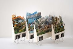 caterina rossato collages various pieces of travel postcards together to create novel, imagined landscapes.