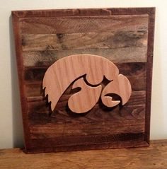 Rustic Iowa Hawkeyes Sign, Michigan Made From Reclaimed Pallets creating a beautiful home decor. The Hawkeye Logo is made from 1/2 Oak hardwood