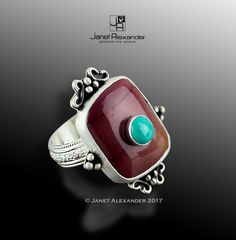 Jasper cabochon 22x 16mm with 6mm Turquoise stone on top. Ring made in sterling silver  with decorations fused onto base. Ring is size 7.
