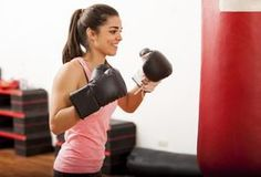 A boxer will typically punch the heavy bag while wearing hand wraps and boxing gloves. However, hitting the bag with bare knuckles has certain advantages. Punching the bag without wraps or gloves can toughen the skin while strengthening the bones, muscles and connective tissue of your hands. Following a few simple techniques will allow you to...