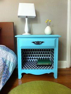 Revive an old bedside table or hutch.  Use wallpaper in the cubby.  Scrapbook paper and modge podge work well too.