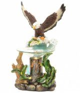"""Eagle poly resin oil warmer. The glass dish holds the scented oil. Brown cylinder gives the warmer a unique look when plugged in. 35 watt halogen bulb heats the oil to release its scent. The power cord has a built in on/off switch and a dial to control the intensity of the heat. Measures approximately 8"""" h x 5""""w"""