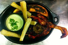 Peruvian BBQ Chicken with yucca fries, creamy salsa verde and plantain and lime a la plancha
