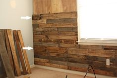 diy wooden wall feature done with wood from pallets. genius.