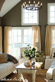 our living room windows would look so much better if trimmed like these. Beautiful room.