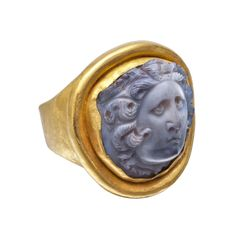 Ancient Roman agate cameo ring in hammered gold, the cameo sculpted in high relief with the facing head of Medusa, her face framed by serpentine locks with two short wings above her forehead. The agate circa 2nd century A.D., mounted in a modern gold ring.