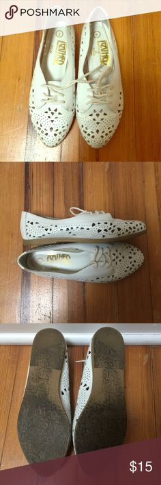 White vintage leather cutout flats size 5 Vintage white leather cutout flats.  Vintage.  Worn a few times.  Embossed rubber soles.  Made in Brazil. **Runs small. Great condition.  Open to offers! Vintage Shoes Flats & Loafers