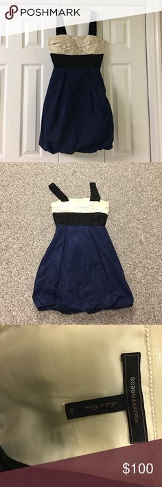Bcbg maxazria dress Beautiful bcbg maxazria mini dress. Size 4. Cute bubble skirt. Cream top. Navy blue skirt with black accent. Was originally strapless but has been altered to add straps. Clean smoke free home excellent condition only worn once. Small spot on the back by hem pictured above. Has been dry cleaned but didn't come out hardly noticeable Very flattering fit.35 inches from shoulder to hem. Pit to pit is 16.5 in laying flat. Side zipper closure. BCBGMaxAzria Dresses Mini