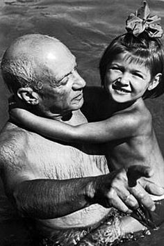 Pablo Picasso and his daughter, Paloma, enjoying the swimming pool -- 1950's.  Picasso adored his children.