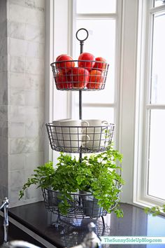 Fall decor in the kitchen!  Simple greenery and apples add a touch of fall.  (Sunny Side Up)