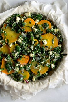 Greek Beet and Beet Greens Pie -  NYT Cooking - This savory pie, seasoned with mint, parsley and dill, is beautiful, filling and easy to assemble. If you are gluten-free and can't use phyllo, you can make this as a crustless gratin.