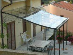Tettoie: Tettoie in ferro battuto, tettoia per terrazzo, tettoia per porta in ferro battuto - pag. 2
