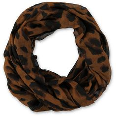Put some wild into your style this summer in the Large Cheetah print brown infinity scarf from David & Young. This super soft and lightweight scarf comes in a brown colorway with black large cheetah print throughout, and can be worn wrapped, folded, tied or layered so your styling options are endless. Pair the D&Y Large Cheetah print brown infinity scarf with a solid tee shirt or tank top and show off your wild side this summer! Love animal print? Shop it all now!