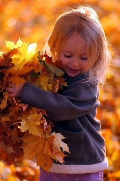 Hands full of autumn leaves - Fall feels.