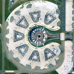 Terminal 1 at Charles de Gaulle Airport in Paris, France - photo from dailyoverview;  It was designed by Paul Andreu in the image of an octopus. While the building's circular center houses key operations such as check-in and baggage claim, the gates are housed in seven satellite buildings connected via underground walkways.  (2/26/15)