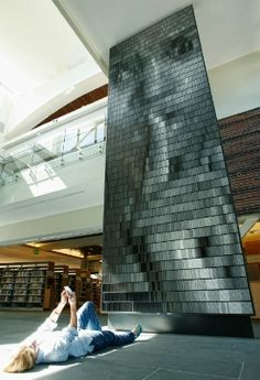 Scandalous Works of Library Art via Bookriot. Sculpture by Christian Moeller, at a library in Walnut Creek, California. Photo from Book Patrol.