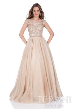Cap sleeve prom gown with illusion neck and back. This prom dress is beaded on the waist and finished with a tulle ball skirt.