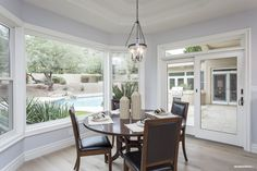 Breakfast room surrounded by windows - perfect for soaking in the morning sun and sipping your coffee!