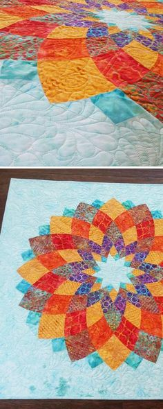 What a beautiful contrast between vibrant reds and light blues. Batik quilts are our fave!