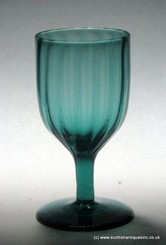 Regency Wrythened Blue-Green Wine Glass A wine glass with a fully wrythened bowl, the optical pattern continues down the stem. Conical foot with snapped pontil. Colored Wine Glasses, Wine Parties, Glass Collection, Antique Glass, Georgian, Glass Art, Peacock Blue, British Isles, Wine Glass