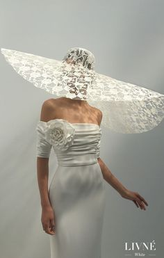 a03140e3feb ... dress by Livné White - A sleeveless ivory wedding gown with drop  shoulders neckline