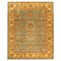 Master Suite - a  bohemian retreat with this beautiful rug, showcasing an exotic-inspired motif and artfully crafted detail. Product: Rug    Construction Material: Wool    Color: Blue and beige  Features: Hand-tuftedNote: Please be aware that actual colors may vary from those shown on your screen. Accent rugs may also not show the entire pattern that the corresponding area rugs have. Cleaning and Care: Professional cleaning recommended     Shipping: Rugs...