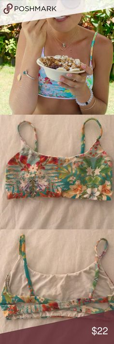 San Lorenzo Bikini Top San Lorenzo Bikini top in a fun, bright tropical pattern 👙🌞🌺 sports bra style fit— perfect for swimming or surfing. Reversible as well; the other side is a stark white. It no longer has the tags, so I am assuming it is a size small or medium. Let me know what size bra you are and we can figure out if this will work for you :) San Lorenzo Swim Bikinis