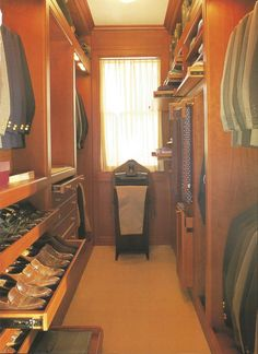If my husband's closet was ever this organized I wouldn't know what to do! Before designing this ultimate men's closet, designer Ellie Cullman had a full inventory of clothes and shoes, and knowledge of what the owner preferred to be folded or hung up.  Photo (C) Nancy E. Hill from my book 'Bedrooms'