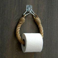 The toilet paper holder consists of natural jute rope and a ., The toilet paper holder consists of natural jute rope and a decoration. The toilet paper holder consists of natural jute rope and a . Industrial Toilets, Industrial Bathroom Design, Rope Decor, Wall Decor, Nautical Bathroom Decor, Vintage Nautical Decor, Parisian Bathroom, Nautical Interior, Nautical Design
