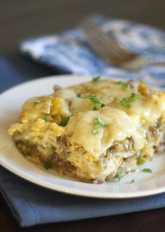 Breakfast Enchiladas are filled with scrambled eggs, sausage, and plenty of green chile ~ recipe by Barefeet In The Kitchen