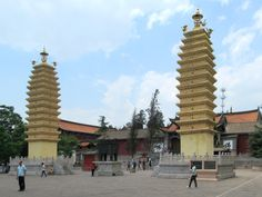 Two Bai-style pagodas stand in front of Miaozhan Temple at Guandu Old Town south of Kunming, Yunnan, China. Kunming, Old Town, Temple, Street View, China, Stone, Old City, Rock, Temples