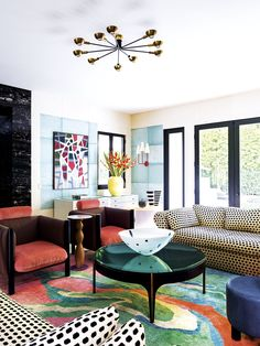 I think there is a little bit of both symmetry and asymmetry in this room. The placement of the chairs is somewhat symmetrical, but the distribution of color creates an off center balance pushing you to the left bottom corner to the darker colors.