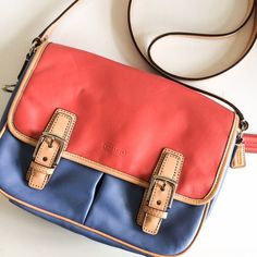 coach / colorblock satchel ⚡2x ️Host Pick⚡️ ➳ coach  ➳ leather color block crossbody ➳ 2 pockets under flap ➳ 1 zip pocket inside ➳ 1 pocket outside  ➳ length: 10in • width: 2.5in  ➳ nwot  ❥ adjustable strap. satin lining in purse. gorgeous blue and coral leather Coach Bags Satchels