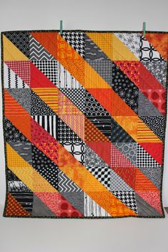 """Modern Baby Quilt """"Sean II""""; Orange; Yellow; Red; Geometric Triangles; Scrap Quilt; Lap Quilt; Play Mat; Wall Hanging; Gender Neutral by iheartbabyquilts on Etsy https://www.etsy.com/listing/253345503/modern-baby-quilt-sean-ii-orange-yellow"""
