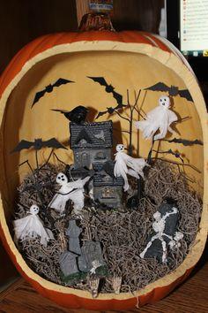Pumpkin diorama...Dollar store house, trees and graveyard pieces. Michaels pumpkin. Handmade gauze ghosts and die cut bats.